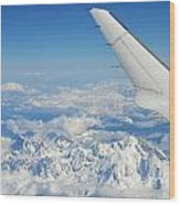 Wings Of Flying Airplane Over French Alps Wood Print