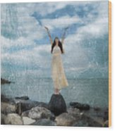Woman By The Sea With Arms Reaching Up In Praise Wood Print