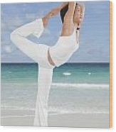 Woman Doing Yoga On The Beach Wood Print