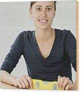 Woman Holding A Spirit Level Wood Print
