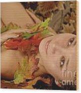 Woman In Fallen Leaves Wood Print