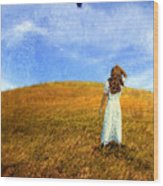 Woman In Field Looking Up At An Airplane Wood Print