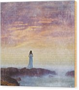 Woman In Vintage Dress At The Rocky Shore At Dawn Wood Print