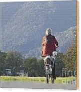 Woman On A Bicycle With Her Dog Wood Print