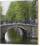 Woman On Bike Wood Print by Ed Rooney
