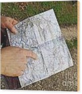 Woman On Country Road Pointing Map Wood Print