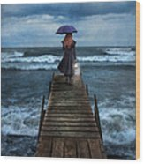 Woman On Dock In Storm Wood Print