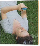 Woman Using Her Iphone Wood Print