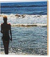 Woman Walking Into Ocean Surf  Wood Print