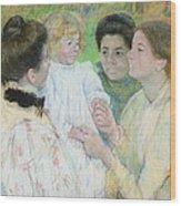 Women Admiring A Child Wood Print by Mary Stevenson Cassatt