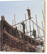 Workers Climb Scaffolding On The Palace Wood Print