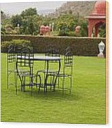 Wrought Metal Chairs Around A Table In A Lawn Wood Print