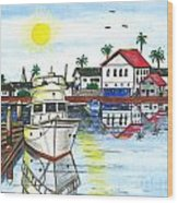 Yacht In Front Of Red Roofs Wood Print