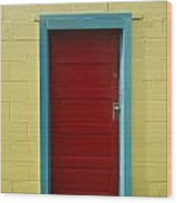 Yellow Wall And Red Door Wood Print