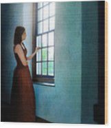 Young Lady Looking Out Window Wood Print