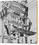 Young Men Working On Telephone Poles Wood Print
