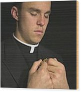 Young Priest Praying With Rosery Wood Print