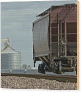 A Lone Grain Hopper Stands Idle On The Tracks Wood Print