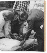 Ambulance Personnel Placing Girl Gurney April Wood Print