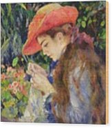 Marie Therese Durand Ruel Sewing Wood Print by Pierre Auguste Renoir