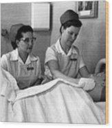 Nurse In Training Bathing Dummy Patient Circa Wood Print