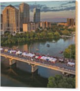 A Beautiful Sunset Falls On The Austin Skyline As Thousands Of Bat Watchers Line The Congress Avenue Bridge During The Annual Bat Fest To Watch The Bats Take Flight Wood Print