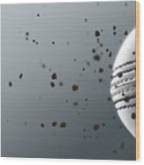 A Dirty White Leather Cricket Ball Caught In Slow Motion Flying Through The Air Scattering Dirt Part Wood Print