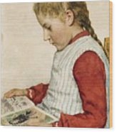 A Girl Looking At A Book Wood Print