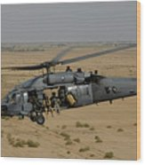 A U.s. Air Force Hh-60 Pavehawk Flies Wood Print