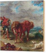An Arab Saddling His Horse Wood Print