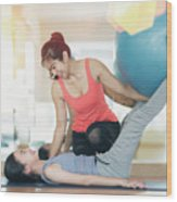 Asian Woman Fitness Coach Teach Her Student For Rubber Ball Exer Wood Print