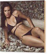 Beautiful Young Woman In Black Bikini On A Pebble Beach Wood Print by Oleksiy Maksymenko