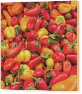 Close Up View Of Small Bell Peppers Of Various Colors Wood Print