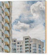 Clouds And Buildings Wood Print