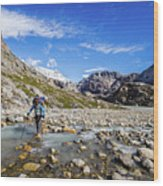 Crossing A River In Patagonia Wood Print