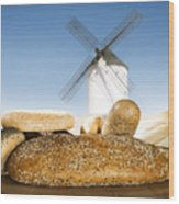 Different Breads And Windmill In The Background Wood Print