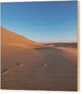 Dune With Magnificent Sandy Waves At Hot And Windy Morning In Desert  Wood Print