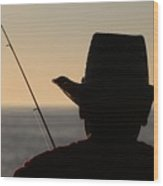 Silhouette Of A Fisherman Wood Print