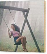 Girl In Swing Wood Print