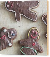 Handmade Decorated Gingerbread People Lying On Wooden Table Wood Print