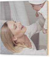 Happy Mother With Her Baby Wood Print