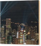 Laser Show Over City At Night Wood Print by Sami Sarkis