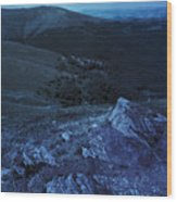 Light On Stone Mountain Slope With Forest At Night Wood Print