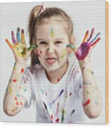 Little Girl Covered In Paint Making Funny Faces. Wood Print