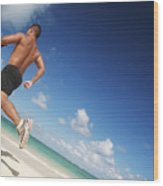 Male Beach Runner Wood Print by Brandon Tabiolo - Printscapes