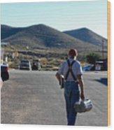 Man Walking With Newspapers Wood Print