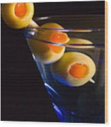 Martini Cocktail With Olives In A Blue Glass Wood Print