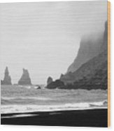 mist rolling in on black sand vik beach and Vik i Myrdal Iceland Wood Print
