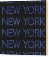 New York - Blue On Black Background Wood Print