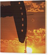 Oil Rig Pump Jack Silhouetted By Setting Sun Wood Print
